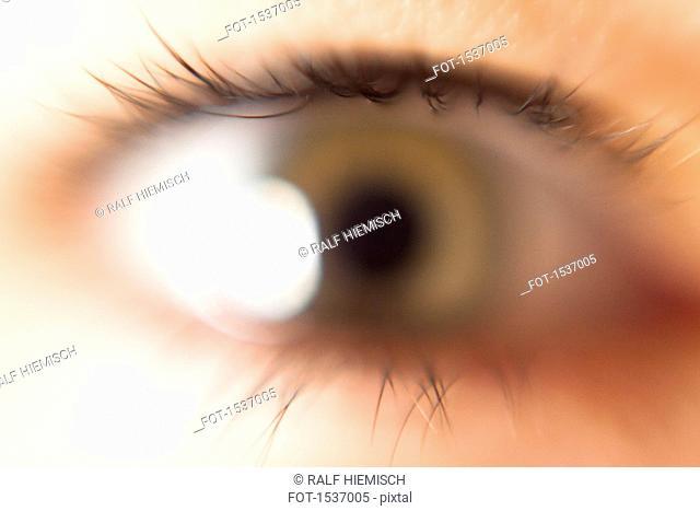 Defocused image of woman's eye