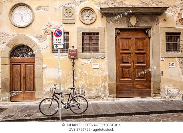 An old door and bicycle in Florence, Italy