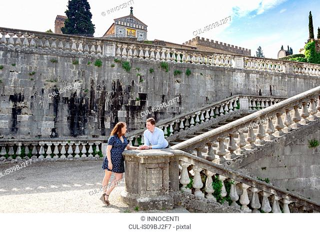 Young couple relaxing by San Miniato al Monte Church, Florence, Toscana, Italy