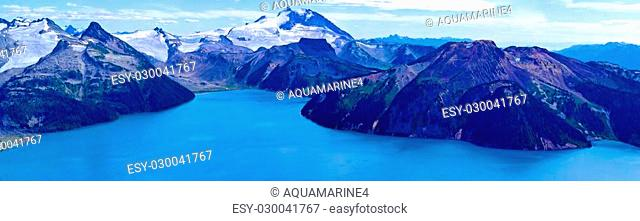 Glorious Garibaldi Lake surrounded with snowcaped mountains. Garibaldi Provincial Park, British Columbia, Canada