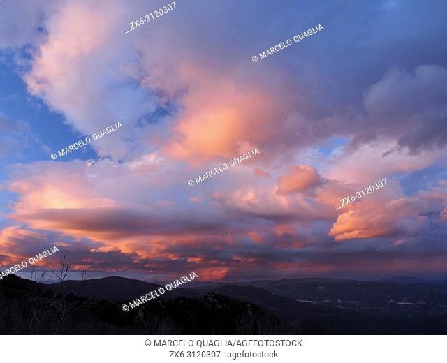 Colorful cloudy dusk seen from Sant Marçal area. Montseny Natural Park. Barcelona province, Catalonia, Spain
