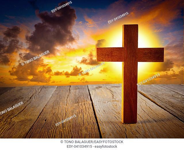 Christian wood cross on sunset sky wooden made