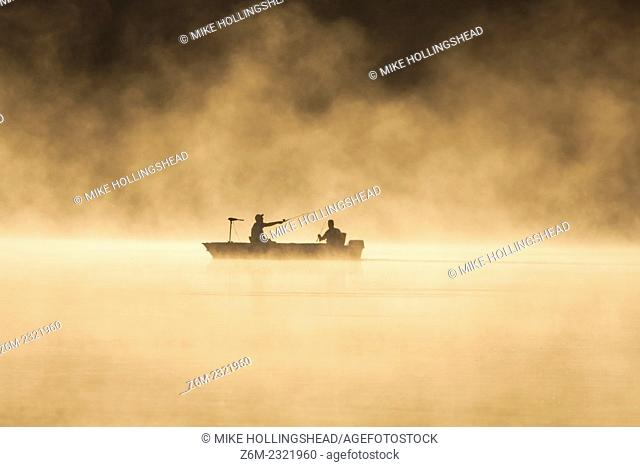 Men fish on a steamy lake August 29, 2008 in western Iowa