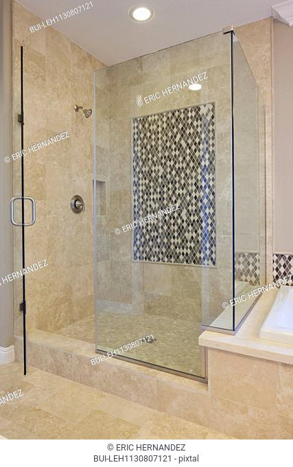 Glass shower cubicle in domestic room; Valencia; California; USA