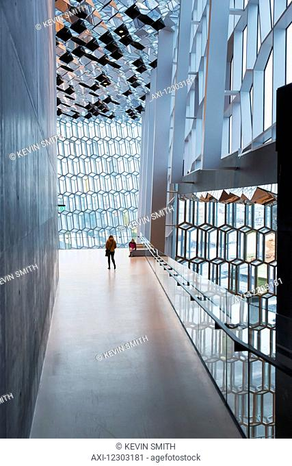 Mother and daughter explore interior of the Harpa public concert hall, designed by the Danish firm Henning Larsen Architects and the Icelandic firm Batteriao...