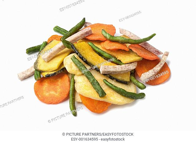 Salted fried vegetable chips on white background
