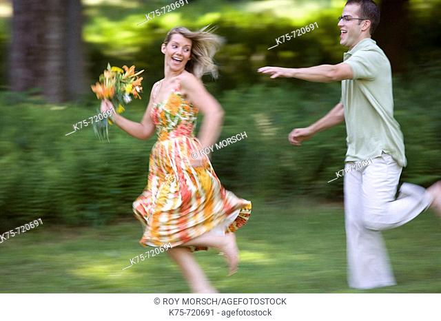 Chasing girl with flowers