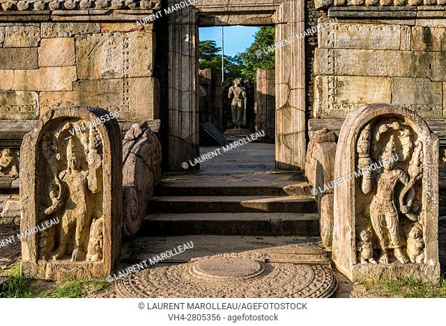 The entrance to the Hatadage with Sandakada pahana, also known as Moon-stone and Nagaraja Guardstone. Ruins of the Hatadage built by King Nissanka Malla...