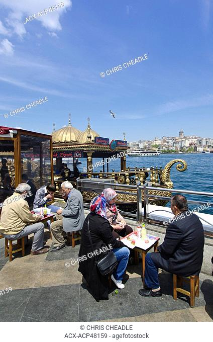Floating restaurants on the Golden Horn by the Galata Bridge, located in the Eminönü district of Istanbul, Turkey