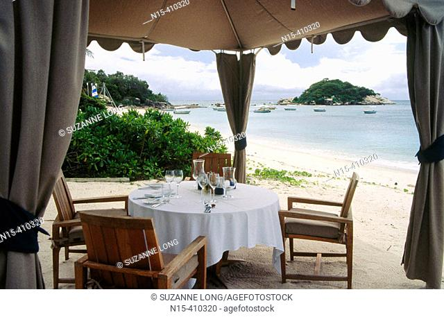 Table set for a romantic dinner on the beach, Lizard Island, Great Barrier Reef Marine Park, Queensland, Australia