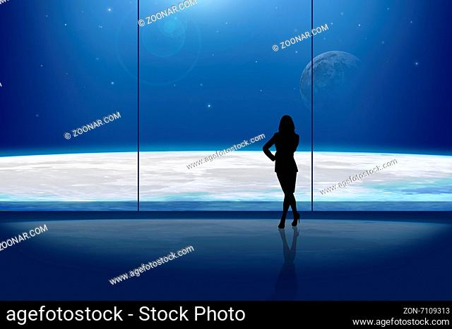 Businesslady in front of the window at night