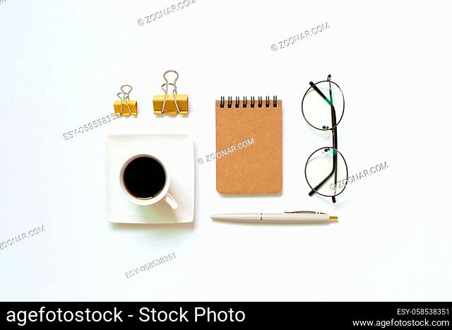 Notebook, pen, cup of coffee, glasses, clip on white background. Work and study place. flat lay, top view, copy space