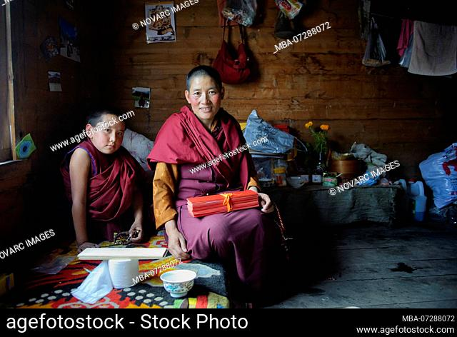 Tibetan monks live in communities. Their cloisters are very basic and their belonging are limited to robes, a few religious figures