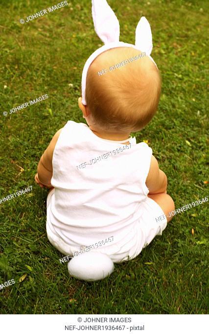 Baby wearing rabbit costume, Djurgarden, Sweden