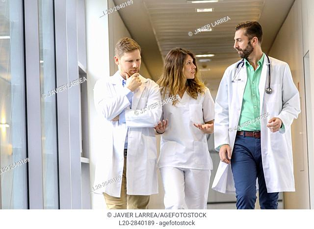 Doctors and nurses walking in corridor, Hospital