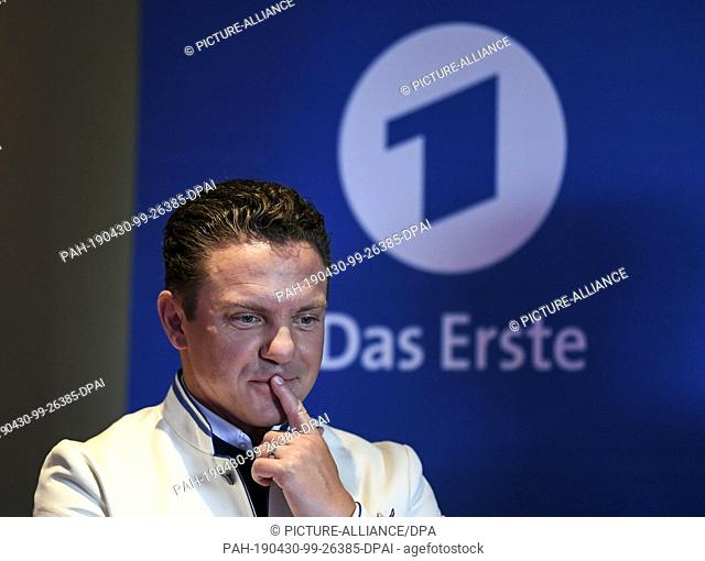 30 April 2019, Baden-Wuerttemberg, Rust: Presenter and musician Stefan Mross gesticulates at Europa-Park during a press conference for this year's season of the...