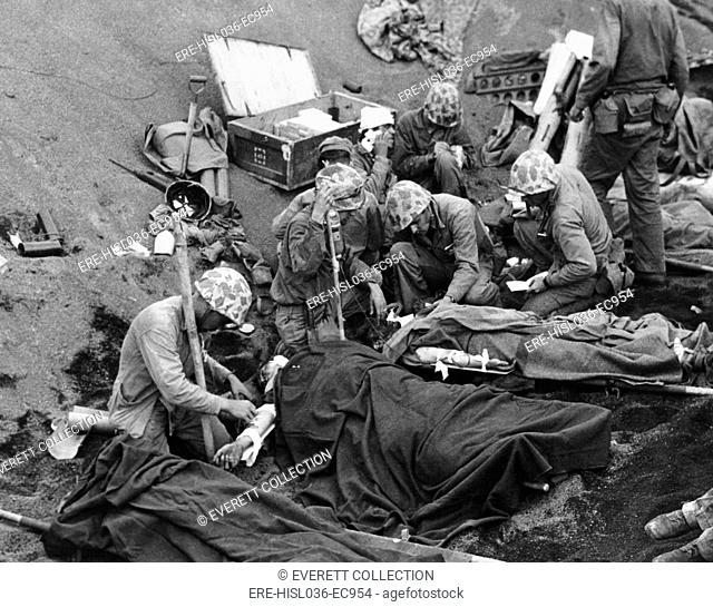 Navy doctors and corpsmen treat seriously wounded Marines on Iwo Jima. Feb. 19-March 26, 1945, during World War 2. (BSLOC-2013-14-255)