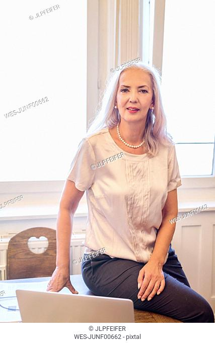 Portrait of businesswoman at home office