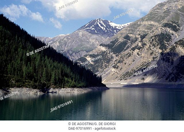 View on Gallo artificial lake or Livigno lake, surrounded by mountain ranges, Lombardy, Italy