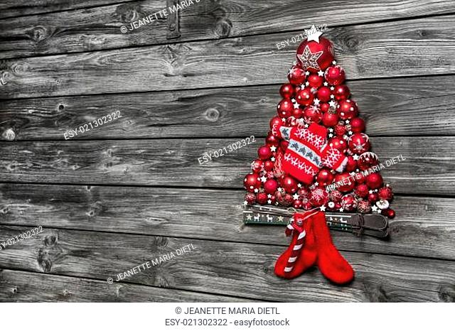 Christmas background of wood decorated with a tree of red balls