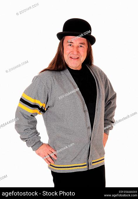 An indigenous man wearing a black hat standing isolated for white background with his Ticercat outfit in the studio