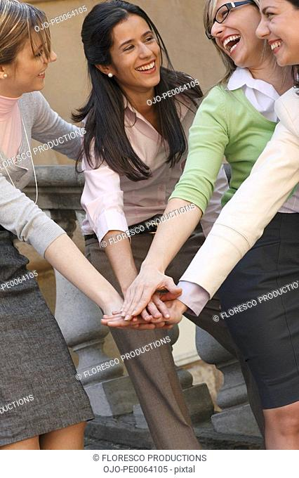Businesswomen in a huddle