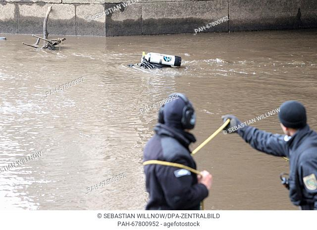A police diver at work in the Elster river basin inLeipzig, Germany, 27 April 2016. After parts of a female body were found in the water near a soccer stadium