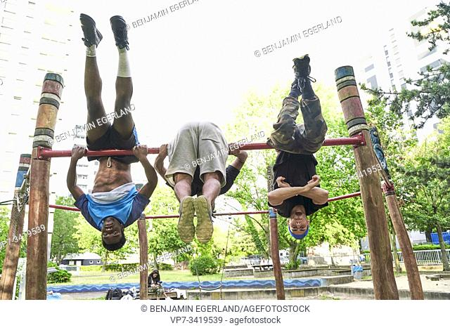 Young men doing acrobatics in park. Frankfurt am Main, Germany