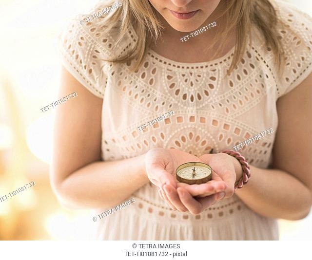Woman holding navigation compass