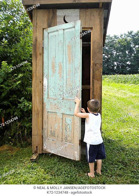 Small Boy Going Into Outhouse