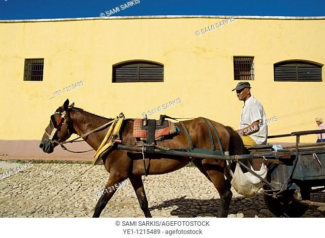 Man riding his horse cart and cart along a paved street, Trinidad, Cuba