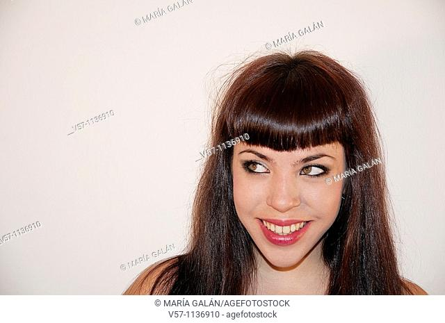 Young woman smiling and looking up. Close view