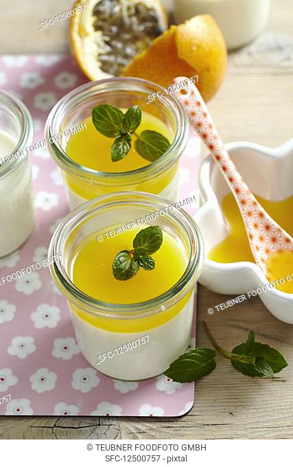Coconut panna cotta with passion fruit sauce in jars