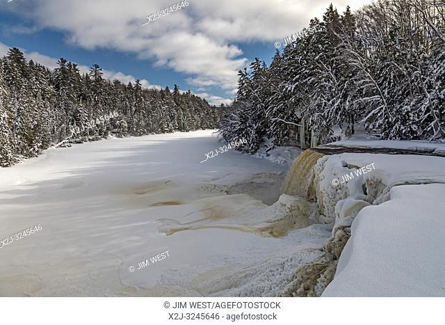 Paradise, Michigan - Tahquamenon Falls and the Tahquamenon River in winter. The falls are located in Tahquamenon Falls State Park, in Michigan's upper peninsula