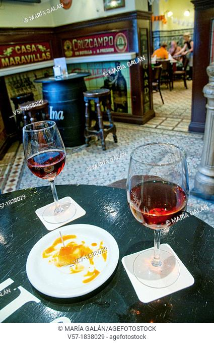 Spanish aperitif: two glasses of rose wine in a typical tavern. Madrid, Spain