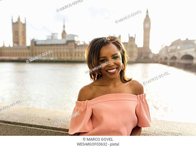 UK, London, portrait of a beautiful woman near Palace of Westminster