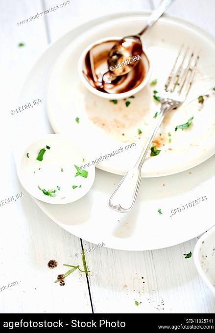 Place setting with the remains of a salad