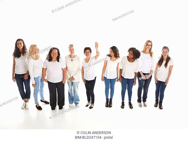 Portrait of smiling diverse women standing in a row