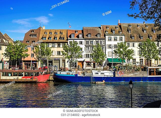 Quai des Pêcheurs fishermen quay with barges on Ill river and waterfront houses Strasbourg Alsace France