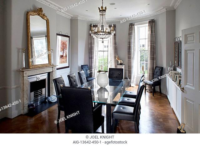 Glass topped dining table in traditional style room, London