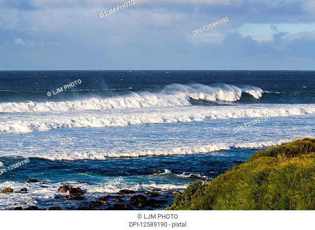Ocean waves cresting on the reef and rolling into the rocks of the shoreline of a beautiful seascape as viewed from the Ho'okipa Lookout near Paia; Maui, Hawaii