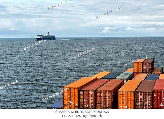 "Cargo ship meets cruise ship """"Mein Schiff"""" on Baltic Sea, Europe"
