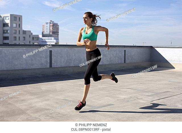 Woman jogging on rooftop