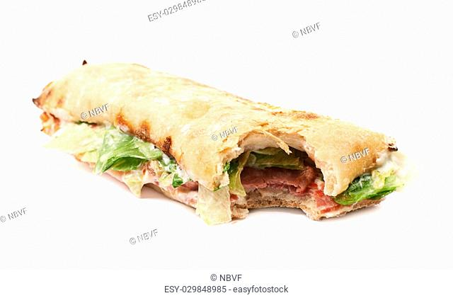 Sub sandwich with a single bite taken of isolated over the white background
