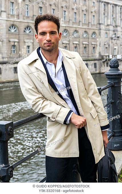 Berlin, Germany. Gay business man strolling the streets of the German Capitol on his way to a his mobile workplace