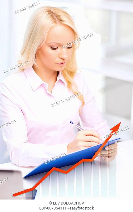 education, business and people concept - businesswoman or student with clipboard and growing graph writing and taking notes in office