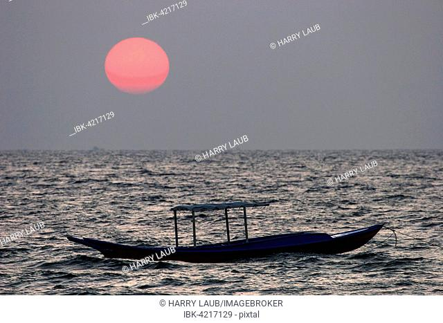 Sunset over the sea, small fishing boat, Ngapali Beach, Thandwe, Rakhine State, Myanmar