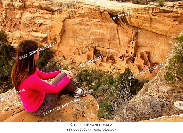 Tourist admiring Square Tower House, Mesa Verde National Park, C