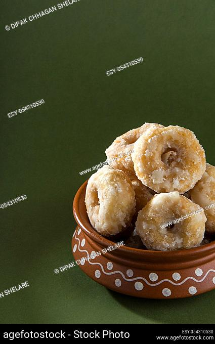 Indian Traditional Sweet Food Balushahi on a olive green background