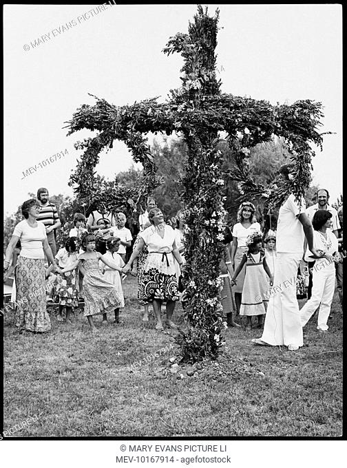 A Scandinavian Midsummer festival, centred around a large cross with floral wreaths on it